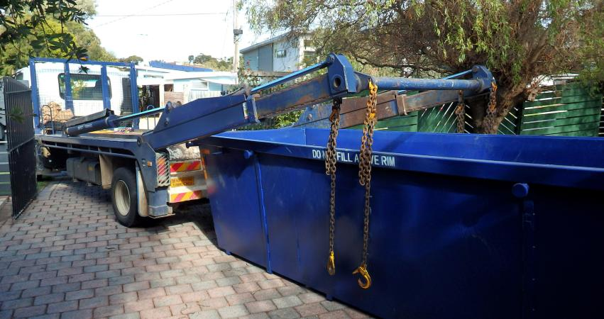 truck delivering empty skip bin