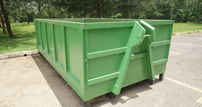 large skip bin in open space parking area