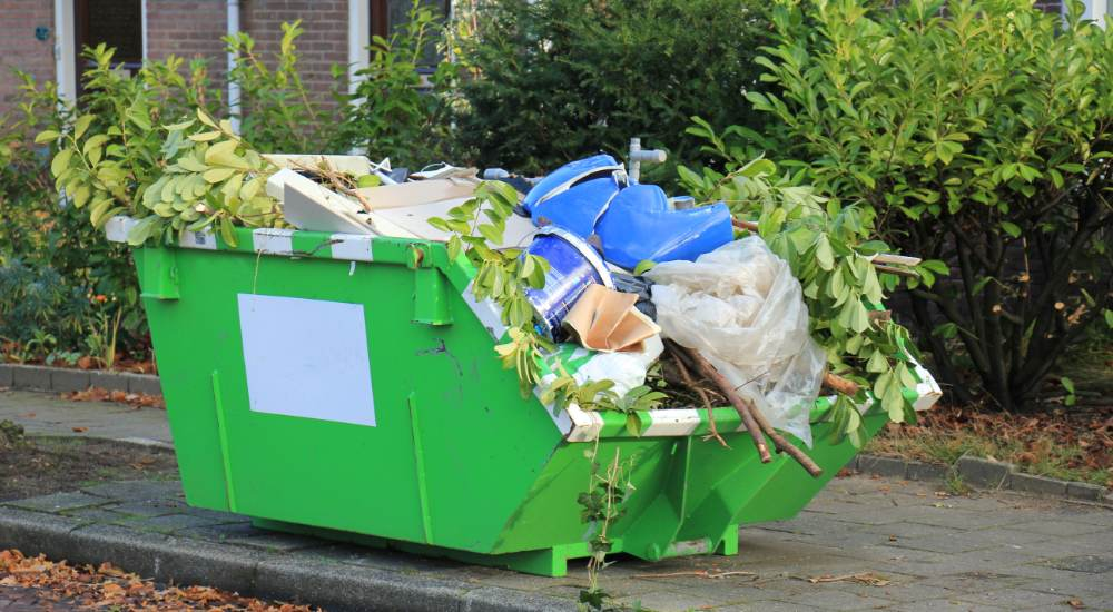 Skip bin out the front of a home